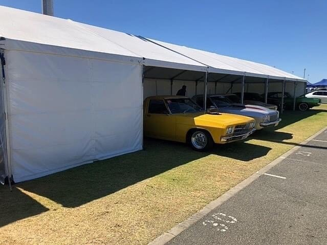 Large marquee with cars on display